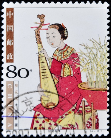 lute: CHINA - CIRCA 2000: A stamp printed in china shows woman playing the lute, circa 2000  Stock Photo