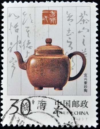 CHINA - CIRCA 1994: A stamp printed in China shows image of antique ceramic teapot, circa 1994 Stock Photo - 10976137