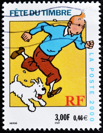 FRANCE - CIRCA 2000: A stamp printed in France shows the cartoon character, Tintin and his dog Snowy, circa 2000