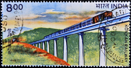 konkan: INDIA - CIRCA 1998: A stamp printed in India shows Konkan Railway image, circa 1998