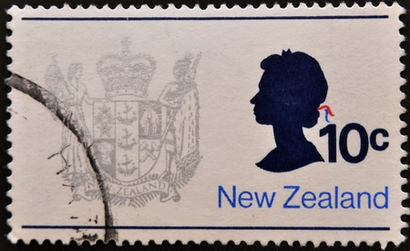 NEW ZEALAND - CIRCA 1970: A stamp printed in New Zealand, shows the New Zealand Coat of Arms and Queen Elizabeth II, circa 1970  photo