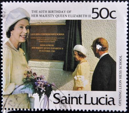 queen elizabeth ii: SAINT LUCIA - CIRCA 1985: A stamp printed in Saint Lucia shows queen Elizabeth II opening leon hess school, circa 1985