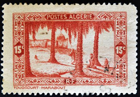 ALGERIA - CIRCA 1936: A stamp printed in Algeria shows Touggourt (marabout), circa 1936  photo