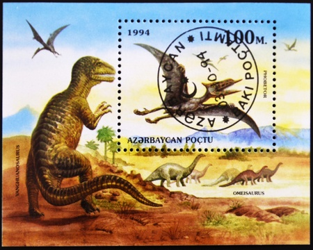 AZERBAIJAN - CIRCA 1994: A stamp printed in azerbaijan shows prehistoric animals, omeisaurus, phobetor, yanghuanosaurus, circa 1994  Stock Photo - 11139867