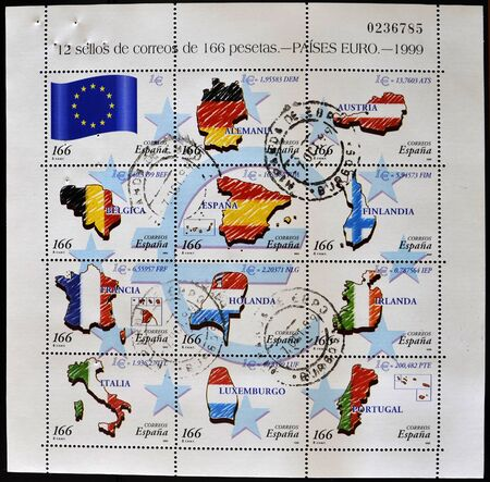 SPAIN - CIRCA 1999: A stamp printed in Spain shows flags of different countries of the European Union, serie, circa 1999 photo