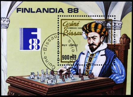 GUINEA BISSAU - CIRCA 1988: A stamp printed in Guinea Bissau shows costumed man playing chess, circa 1988 photo