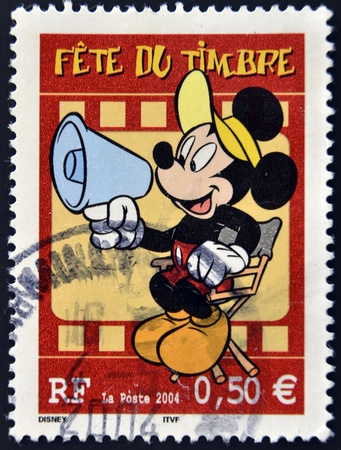 FRANCE - CIRCA 2004: A stamp printed in France shows Mickey Mouse as a film director, circa 2004