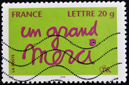FRANCE - CIRCA 2000: A stamp printed in France shows words in French a big thank you, circa 2000  photo