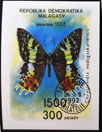 MADAGASCAR - CIRCA 1992: A stamp printed in Madagascar shows a butterfly, chrysirridia madagaskariensis, circa 1992  photo