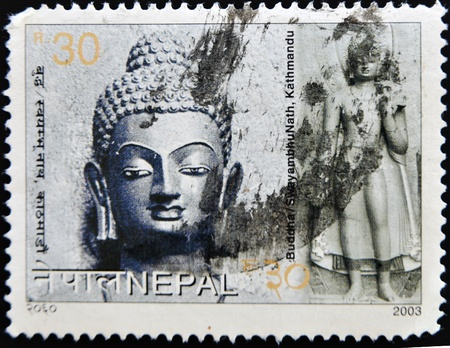 NEPAL - CIRCA 2003: A stamp printed in Nepal shows Buddha and SwayambhuNath, Kathmandu, circa 2003  photo