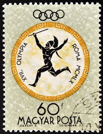 HUNGARY - CIRCA 1960: A post stamp printed in Hungary shows sportsman, devoted Olympic games in Rome, series, circa 1960  Stock Photo - 11104222
