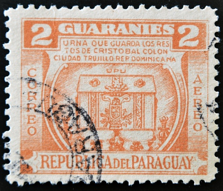 PARAGUAY - CIRCA 1952: A stamp printed in Paraguay shows urn that holds the remains of Christopher Columbus, the city of Trujillo in the Dominican Republic, circa 1952 photo
