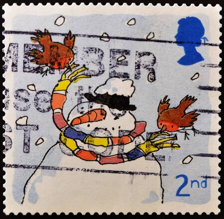 UNITED KINGDOM - CIRCA 2001: A stamp printed in England, is dedicated to Christmas, depicts snowman wearing a scarf, circa 2001  Stock Photo - 11099021
