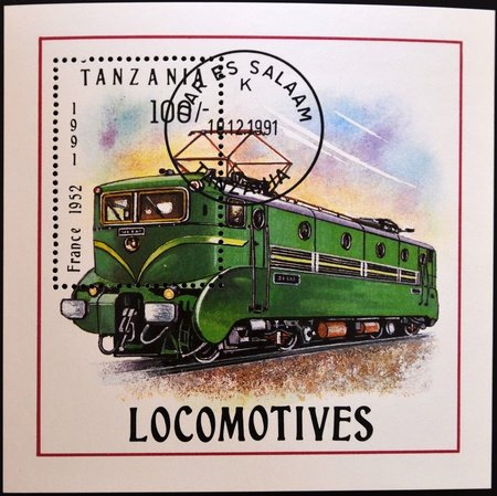TANZANIA - CIRCA 1991: A stamp printed by Tanzania shows an old locomotive produced in France 1952, circa 1991.  photo