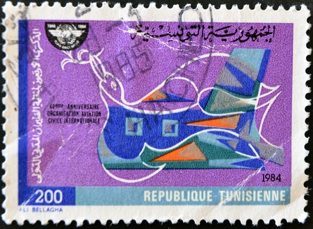 TUNISIA - CIRCA 1984: A stamp printed in Tunisia commemorating the 40th anniversary of the international civil aviation organization, circa 1984  photo