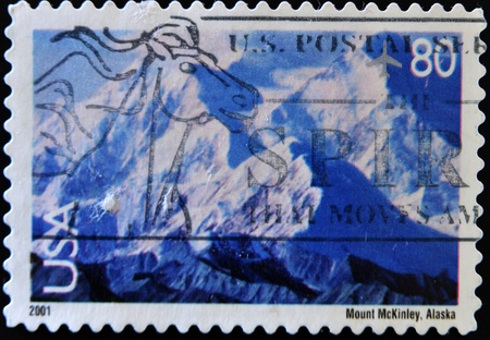 UNITED STATES OF AMERICA - CIRCA 2001: A stamp printed in the United States of America shows image of Mount McKinley in Alaska, circa 2001  Stock Photo - 11104200