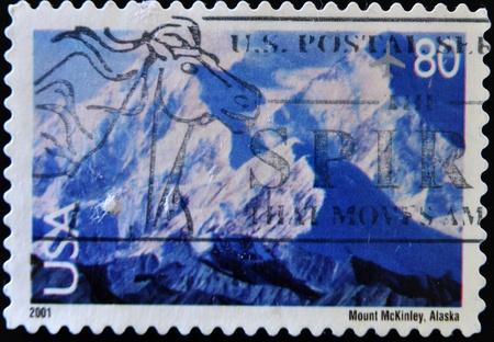 UNITED STATES OF AMERICA - CIRCA 2001: A stamp printed in the United States of America shows image of Mount McKinley in Alaska, circa 2001 Stock Photo - 11104200