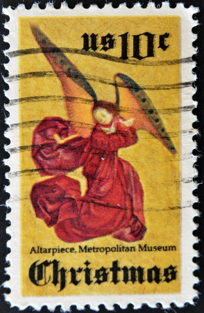 UNITED STATES OF AMERICA - CIRCA 1974: A stamp printed in the United States of America shows Angel from Perussis altarpiece, Metropolitan museum, circa 1974  photo