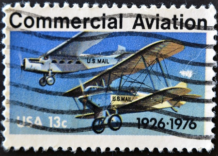 monoplane: UNITED STATES OF AMERICA - CIRCA 1976: a stamp printed in the USA shows planes, Ford-Pullman Monoplane and Laird Swallow Biplane, circa 1976  Stock Photo