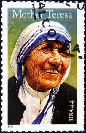 veneration: UNITED STATES OF AMERICA - CIRCA 2010: A stamp printed in USA shows mother Teresa, circa 2010  Editorial