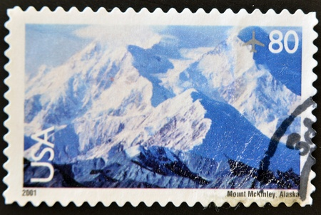 united states postal service: UNITED STATES OF AMERICA - CIRCA 2001: A stamp printed in the United States of America shows image of Mount McKinley in Alaska, circa 2001
