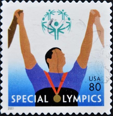 philatelist: UNITED STATES OF AMERICA - CIRCA 2003: Ein Stempel in den Vereinigten Staaten von Amerika gedruckt zeigt Bild feiert den Special Olympics, Serie, circa 2003 Editorial