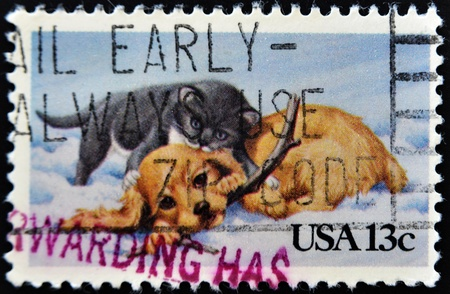 UNITED STATES OF AMERICA - CIRCA 1982: a Christmas issue stamp printed in the USA shows image of a cat and dog, circa 1982  photo