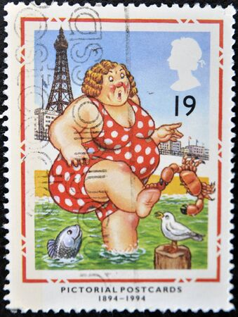 the bather: UNITED KINGDOM - CIRCA 1994: A stamp printed in Great Britain shows Bather at Blackpool (Pictorial Postcards 1894-1994), circa 1994