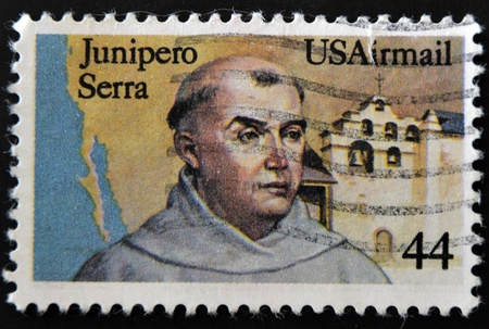 UNITED STATES OF AMERICA - CIRCA 1985: a stamp printed in USA shows Fr. Junipero Serra, California Missionary and San Gabriel Mission,  circa 1985  Stock Photo - 11277055