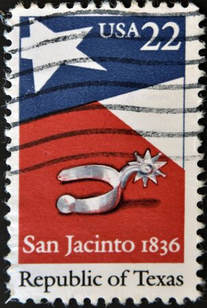 UNITED STATES OF AMERICA - CIRCA 1980 : Stamp printed in USA shows spur, star, flag and the inscription