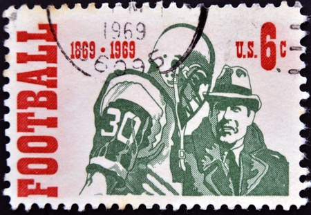 card player: UNITED STATES OF AMERICA - CIRCA 1969: A stamp printed in USA dedicated to american football, circa 1969 Stock Photo