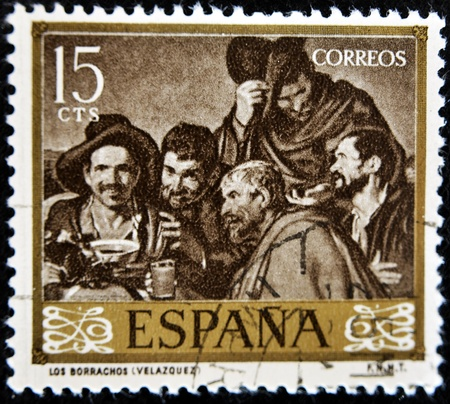 velazquez: SPAIN - CIRCA 1959: A stamp printed in spain shows the box drunkards by Diego Velazquez, circa 1959
