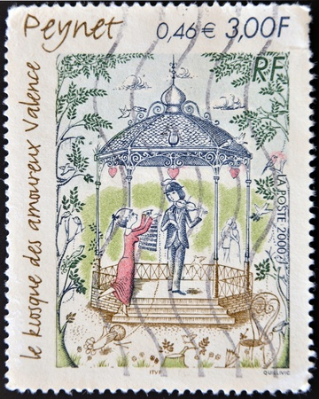 FRANCE - CIRCA 2000  A stamp printed in France shows the illustration the kiosk of lovers by Peynet, circa 20002