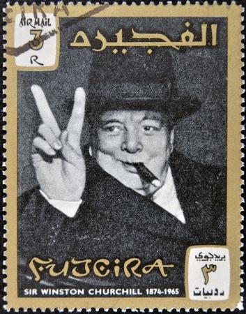 fujeira: FUJERIA - CIRCA 1965: A stamp printed in Fujeira shows image of sir winston churchil, 1874-1965, circa 1965  Editorial