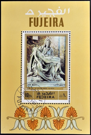FUJEIRA - CIRCA 1971: A stamp printed in Fujeira shows The Pieta by Michelangelo, circa 1971