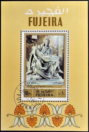 fujeira: FUJEIRA - CIRCA 1971: A stamp printed in Fujeira shows The Pieta by Michelangelo, circa 1971  Editorial