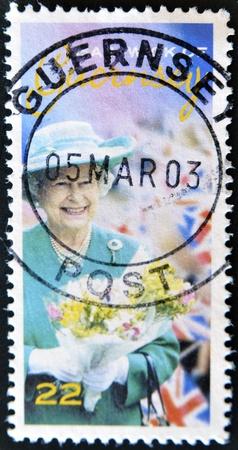 GUERNSEY - CIRCA 2003  A stamp printed in Guernsey shows Queen Elizabeth II, circa 2003  Stock Photo - 12570852