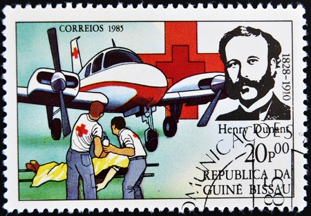 henry: GUINEA BISSAU - CIRCA 1985  A stamp printed in Guinea Bissau shows Henry Dunant, founder of the Red Cross charity, circa 1985
