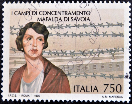 concentration camp: ITALY - CIRCA 1995  A stamp printed in Italy shows concentration camp Mafalda of Savoy, circa 1995