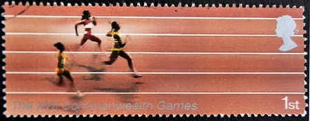 UNITED KINGDOM - CIRCA 2005  A Stamp printed in Great Britain showing Athletics, XVI commonwealth games, circa 2005  Stock Photo - 12445451