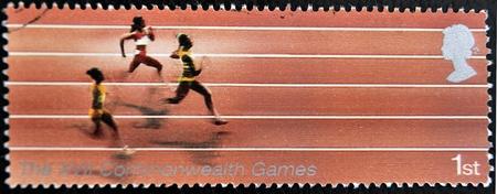 UNITED KINGDOM - CIRCA 2005  A Stamp printed in Great Britain showing Athletics, XVI commonwealth games, circa 2005  Stock Photo - 12445451