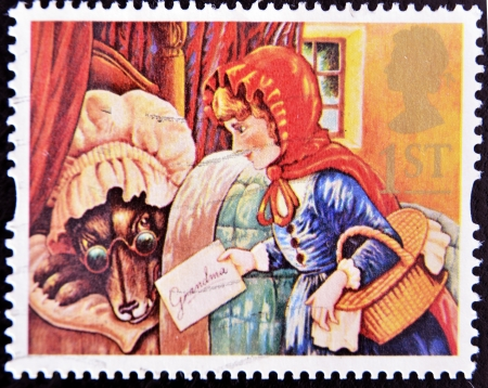little red riding hood: UNITED KINGDOM - CIRCA 1994: A stamp printed in Great Britain shows Little Red Riding Hood and the wolf as Grandma, circa 1994
