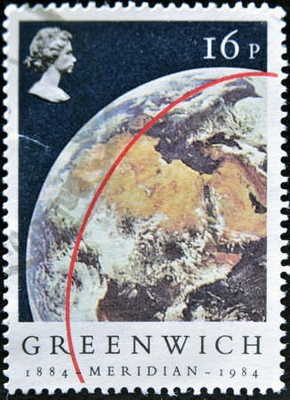 UNITED KINGDOM - CIRCA 1984  A stamp printed in Great Britain shows red line on Globe with the inscription  GREENWICH 1884-MERIDIAN-1984 , circa 1984  Stock Photo - 12445452
