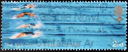 UNITED KINGDOM - CIRCA 2005  A Stamp printed in Great Britain showing swimmers, XVI commonwealth games, circa 2005 Stock Photo - 12445456