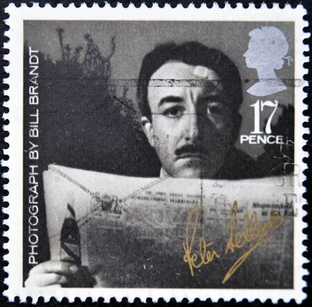 brandt: UNITED KINGDOM - CIRCA 1985: A stamp printed in Great Britain shows Peter Sellers - Photograph by Bill Brandt, circa 1985