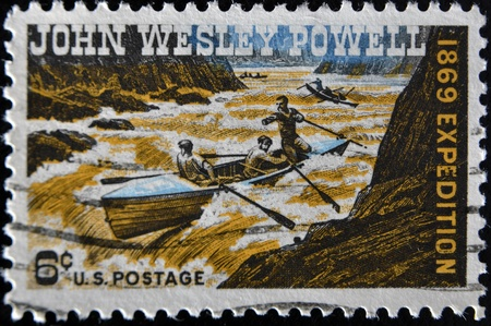 wesley: UNITED STATES OF AMERICA - CIRCA 1969: a stamp printed in the United States of America shows John Wesley Powell Exploring Colorado River, circa 1969