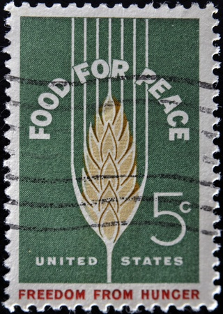 UNITED STATES OF AMERICA - CIRCA 1960: A stamp printed in USA shows image of the dedicated to the Food For Peace circa 1960  Stock Photo - 11813664