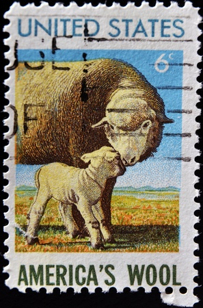 UNITED STATES OF AMERICA - CIRCA 1985: A stamp printed in United States honoring American Wool Industry shows sheep with lamb, circa 1985  photo