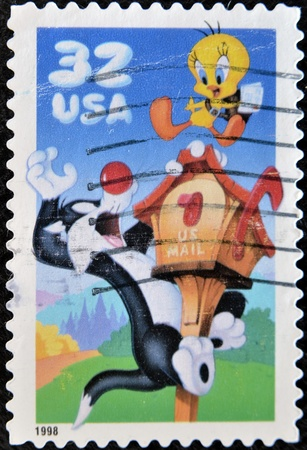 sylvester: UNITED STATES OF AMERICA - CIRCA 1998: A stamp printed in USA shows Sylvester and Tweety, circa 1998