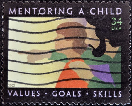 UNITED STATES OF AMERICA - 2002: A stamp printed in the United States of America shows image of a child being mentored, series, 2002  photo